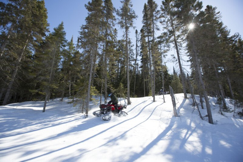 Powersports track systems ATV riders forest snow